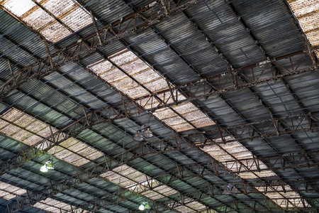 Background of a rusty corrugated iron roof with skylights. Stock Photo