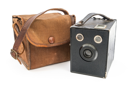 Vintage Box Brownie Camera and a brown canvas case over white.