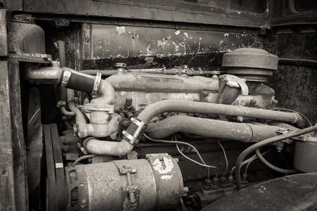A rusty and dirty old bus engine. Stock Photo