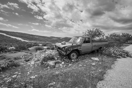 Rusty abandoned truck in a rural landscape. abandoned truck in a rural landscape.