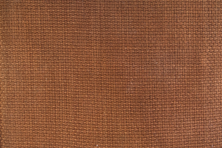Brown canvas material textured background.