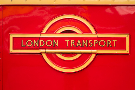 WEYBRIDGE, SURREY, UK - AUGUST 9, 2015: A vintage Red London Transport badge on a vintage London bus at the London Bus Museum at Brookland Motor Museum in August, 2015. Editorial