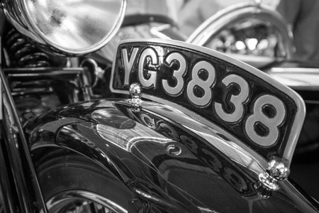 WEYBRIDGE, SURREY, UK - AUGUST 9, 2013: A grainy black and white image of a number plate on a vintage Motorbike at Brooklands Motor Museum in August, 2013.