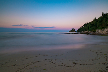 Long exposure of a beach at sunset. Stock Photo