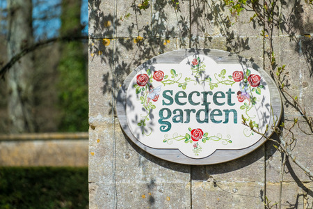 Secret garden sign on a wall.