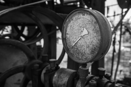 Rusty old pressure gauge in black and white. Stock Photo