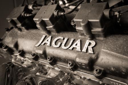 motor cars: WEYBRIDGE, SURREY, UK - AUGUST 9, 2015: Close up black and white Classic Jaguar Car enigine on display at Brooklands Motor Museum in 2015.