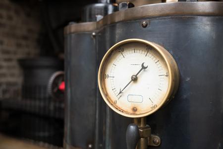 Old industrial pressure gauge. Stock Photo
