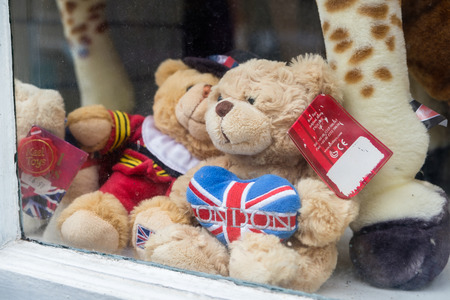 WINDSOR, UK - MARCH 18, 2017: Teddy bears in a souvenir shop window in the popular tourist town on Windsor in March 2017. Editorial