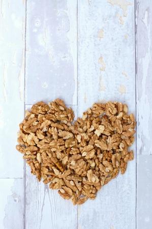 coeliac: Walnut heart on the grey wood background, vertical overhead