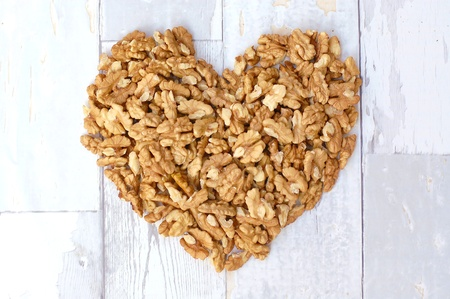 coeliac: Walnut heart on the grey wood background, horizontal overhead