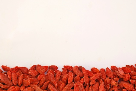 suger: Chinese goji on the long side  on the white background, overhead horizontal view
