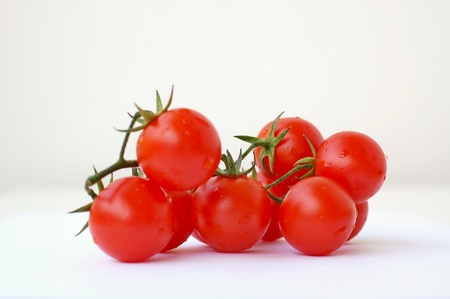 Tomatoes on the white background, front horizontal view