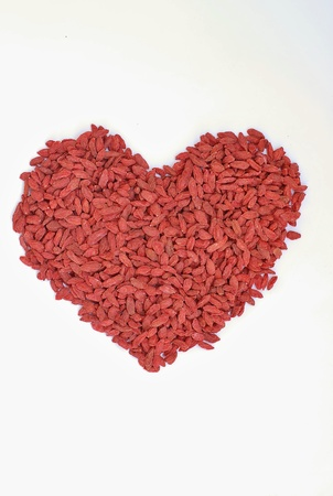 Heart of Chinese goji on the white background, overhead vertical view Stock Photo