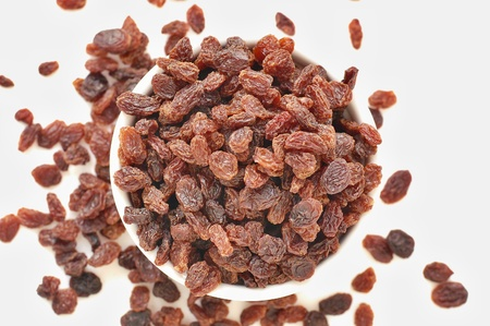 Raisens in the bowl on the white background, overhead horizontal view Stock Photo