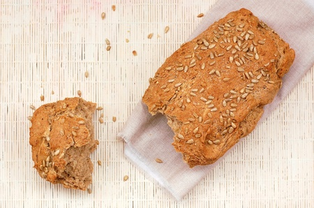Bread with sunflower seeds on the white background, overhead horizontal view Stock Photo