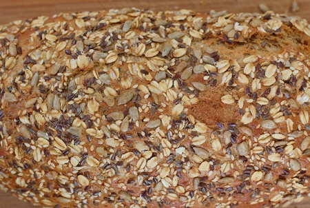 sunflower seeds: Wholegrain bread with seeds on the wood, overhead horizontal view