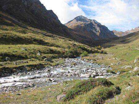 mountain river making its way through the alpine scenery