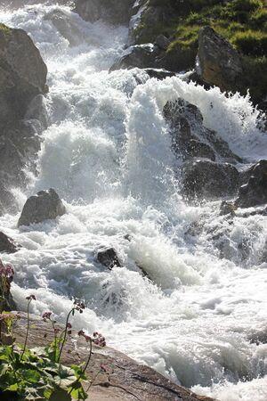Torrential mountain river in the alps in Switzerland