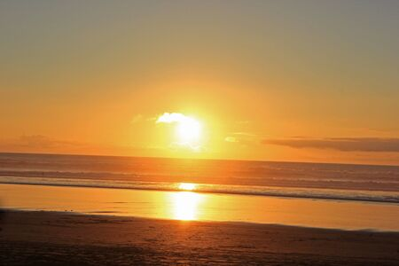 Sunset at muriwai beach in new zealand Banco de Imagens