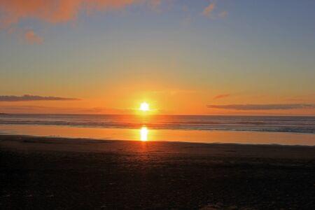 awesome sunset at muriwai beach