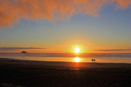 colorful sunset at muriwai beach