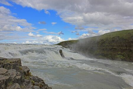 huge gulfoss waterfall in iceland on quite sunny day Stok Fotoğraf