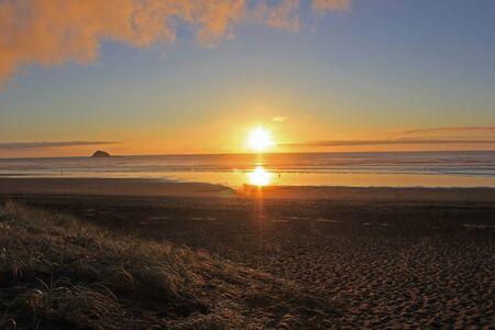 romantic sunset at muriwai beach