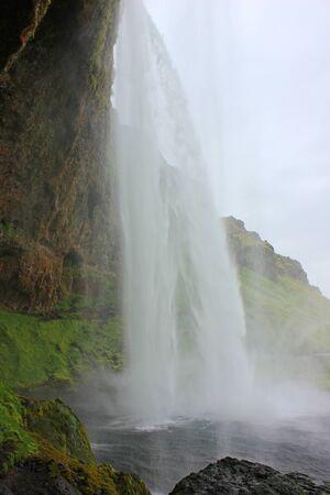 Behind the impressive seljalandsfoss waterfall
