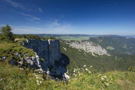 Creux du Van mountain on a sunny day Stock fotó