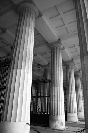 passageway: Historical column passageway with iron gate Stock Photo
