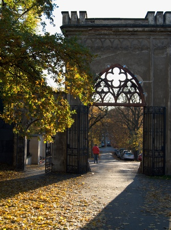 Historic park gate backlit with evening sun in the autumn Stock Photo