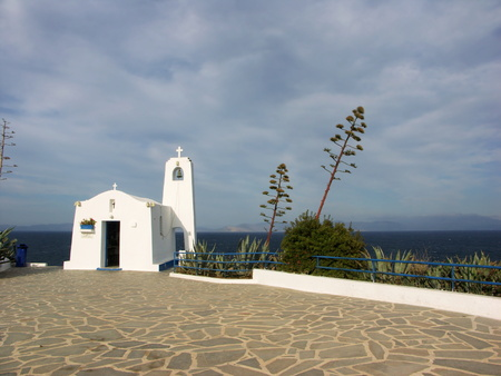 chappel: A small white greek chappel with high agave plant