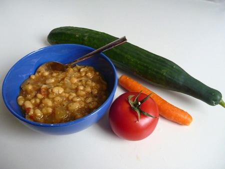 beans soup: a blue bowl vith beans soup and vegetables