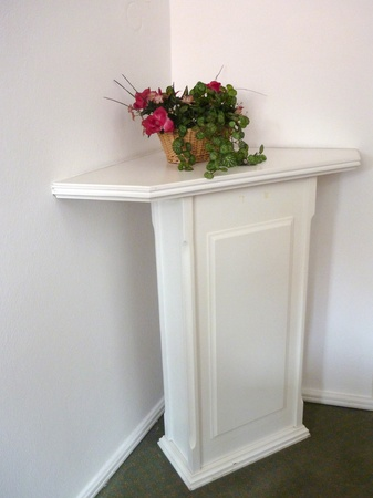 white decorative table for plant in a corner Stock Photo