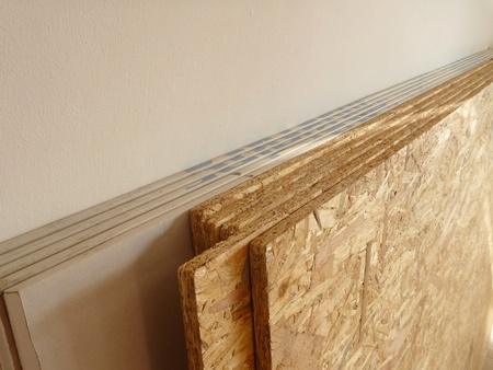 stock of oriented strand board and plaster board prepared for construction