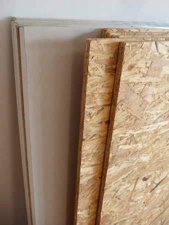 plaster board: stock of oriented strand board and plaster board prepared for construction
