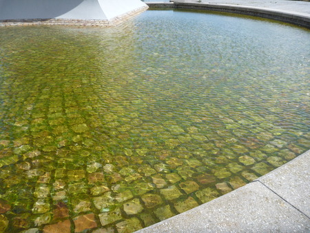 paved: a water fountain bottom paved with cobbles Stock Photo