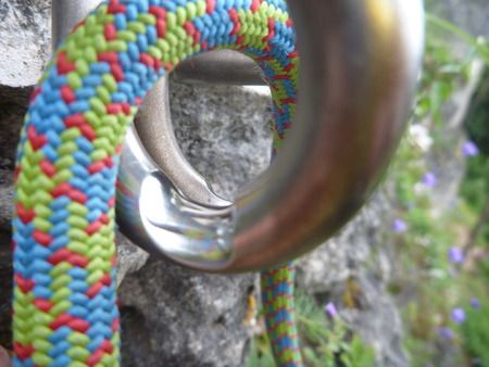 too much used rapelling top metal device on a sport climbing route