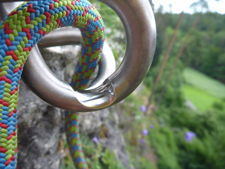 rapelling: too much used rapelling top metal device on a sport climbing route