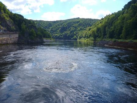 unpredictable: unpredictable whitly water under a big dam