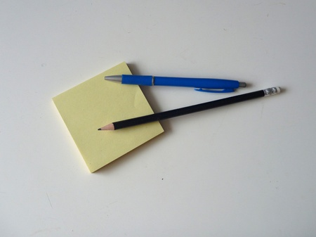 exercisebook: some various basic office accesories on a white table