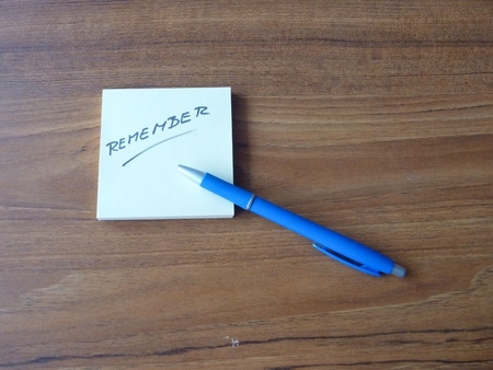 forgetful: a yellow office paper reminder with a message