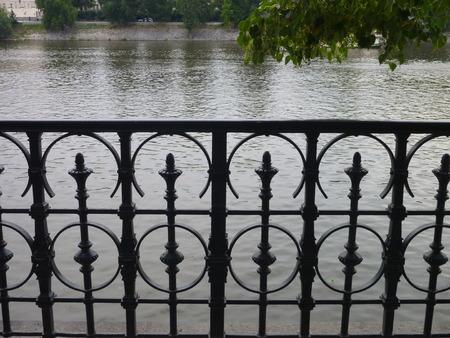 railing: a decorative carved railing on a bridge