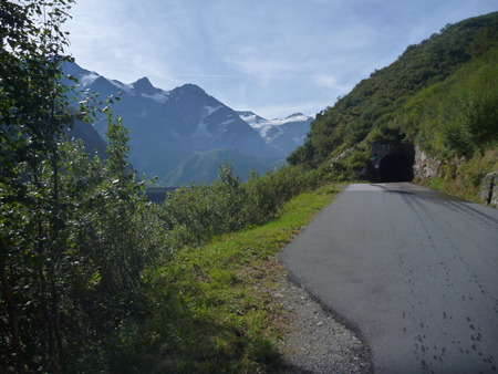 asphalted alpine road with a  mountain panorama