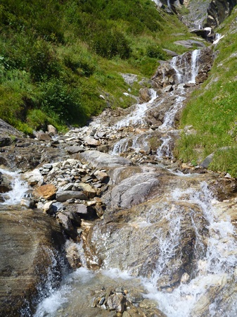 rock creek: a pure alpine creek falling down the rock Stock Photo