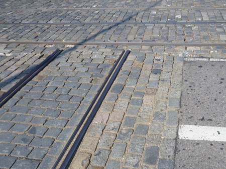 cobbles: a city tram lines crossing on cobbles Stock Photo
