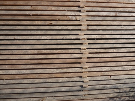 lumber mill: many stocked wooden planks for a construction Stock Photo