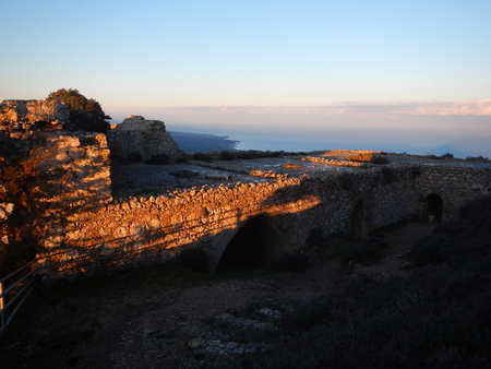 moat wall: medieval kantara castle in cyprus in a romanric sunrise Stock Photo