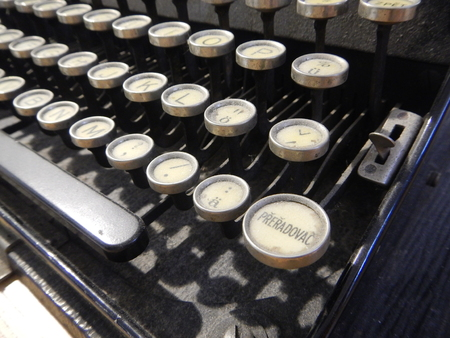 qwerty: a detail of an old type writer keyboard
